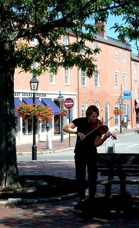 JIM VAIKNORAS/Staff photo Lewis Flowers of Haverhill plays violin in Market Square in Newburyport Friday.