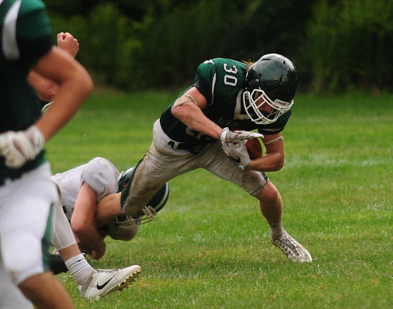 JIM VAIKNORAS/Staff photo Pentucket's Liam Sheehy tries to break a tackle during their game against Canton Saturday at Pentucket. The Sachems lost the game 6-0.