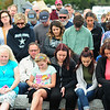 JIM VAIKNORAS/Staff photo The families of those who died at sea and community members bow their heads during the Relocation Ceremony for the Newburyport Fisherman's Memorial on the boardwalk on the Newburyport Waterfront Monday morning.
