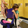 BRYAN EATON/Staff Photo. Seeming to have an endless amount of supplies in her backpack, Sophia Nelson and Mia Karapoulos, left, both 7, unload them into their lockers at the Bresnahan School. Yesterday was the first day for Newburyport, Amesbury and Pentucket District Schools.
