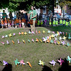 "BRYAN EATON/Staff photo. Standing near pinwheels in the design of a peace sign, Newburyport Montessori School music teacher Neal Ferreira led students in song on the grounds of the Unitarian Church. Wednesday was the International Day of Peace and Montessori schools around the world celebrated by singing ""Light a Candle For Peace."""