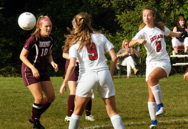 BRYAN EATON/Staff photo. Amesbury's Ashley Pettet knees the ball into Rockport territory.