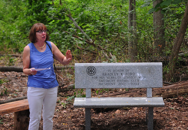 JIM VAIKNORAS/Staff photo Lee Ford speaks at a dedication of a bench behind Amesbury Middle School in memory of her husband Bradley Ford former president of the Rotary Club.