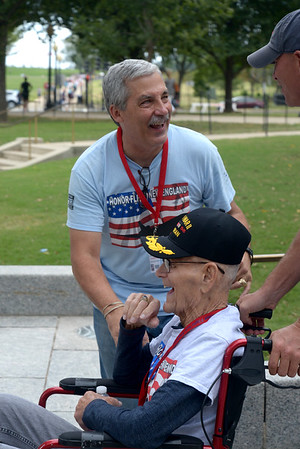 JIM VAIKNORAS/Staff photo World War 2 veteran Dexter Murray and his son in law Jonathan Pratt share a laugh with Joe Byron founder of Honor Flight New England, a non profit out of Hocksett New Hampshire that provide flght to and tours of the capital.