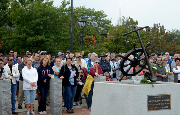 JIM VAIKNORAS/Staff photo People crowd for the Relocation Ceremony for the Newburyport Fisherman's Memorial on the boardwalk on the Newburyport Waterfront Monday morning.