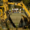 BRYAN EATON/Staff photo. Newburyport girls soccer players are framed by heavy equipment at Fuller Field on Low Street. The track at the field is being replaced.