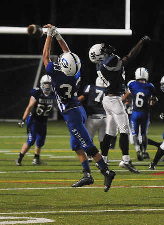 JIM VAIKNORAS/Staff photo  Georgetown's Anthony D'Amato breaks up a pass against Matignon at Georgetown Friday night.