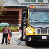 BRYAN EATON/Staff photo. Triton Regional schools went back to school yesterday as other area schools started before the Labor Day Weekend. Youngsters jumped of the school bus in the drizzle at Salisbury Elementary School.