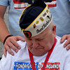 JIM VAIKNORAS/Staff photo Pearl Harbor Survivor Joseph Mielesko is comforted by his guardian at the WW2 Memorial in Washington DC Sunday, they were part of a group  who flew from Boston for the day with Honor Flight New England, a no profit out of Hocksett New Hampshire that provide flght to and tours of the capital.
