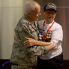 JIM VAIKNORAS/Staff photo General Richard Erickson hugs his dad World War 2 veteran Hubert Erickson after his arrival at Logan Airport Sunday.
