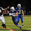 JIM VAIKNORAS/Staff photo  Georgetown's Mark Mansfield runs for a touchdown against Matignon at Georgetown Friday night.