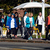BRYAN EATON/Staff photo. Walkers supporting Ovarian Cancer Awareness Month head throught Newburyport's downtown on Sunday. There was also a 5K race with both starting and ending in the parking lot at Michael's Harborside.