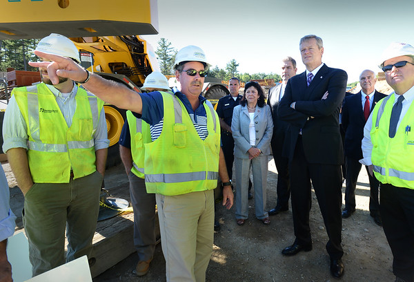 BRYAN EATON/Staff photo. Ernie Monroe, resident engineer of the Whittier Bridge project, shows progress on the second bridge to Governor Charlie Baker.