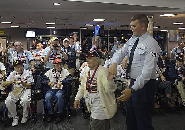 JIM VAIKNORAS/Staff photo Josephine Miller dances with Senior Ariman Clinton Trefwyn at BWI airport in Baltimore.
