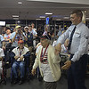 JIM VAIKNORAS/Staff photo Josephine Miller dances with Senior Ariman Clinton Trefwyn at BWI airport in Baltimore.