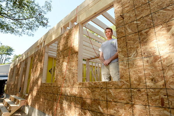 BRYAN EATON/Staff photo. Local developer George Haseltine at the new home going up on 4 Moulton Street in Newburyport. The previous home was removed piece by piece to be sold as recycled building material.