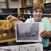 BRYAN EATON/Staff photo. Amesbury Public Library Teen, Local and Reference librarian Margie Walker is arranging for old photos of Amesbury to be posted on the bike trail.