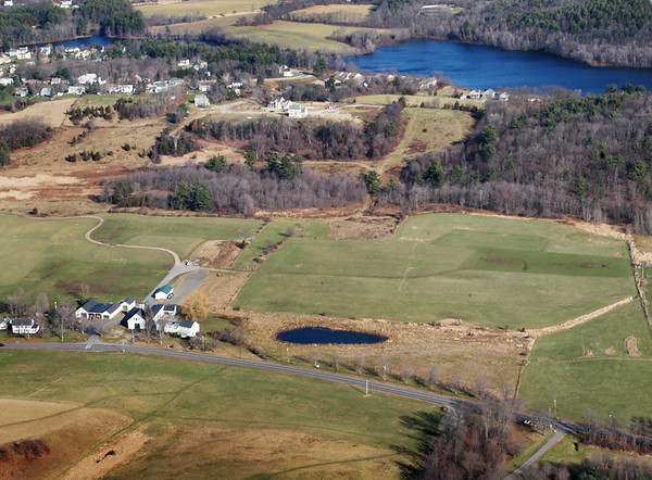 BRYAN EATON/File photo. The northern end of Whittier Hill in Amesbury is above the pond at Woodsom Farm where woodland opens to a field. Lake Gardner can be seen beyond that.