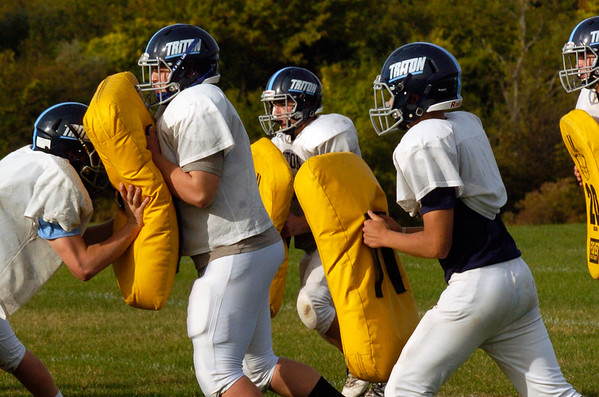 BRYAN EATON/Staff photo. Triton's defense in action during practice.