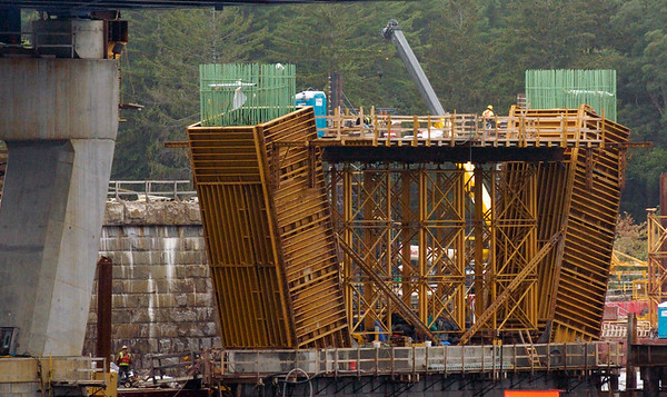 BRYAN EATON/Staff photo. A worker can be seen on the top of what is to be a pier on the Newburyport side of the second bridge being built on Interstate 95 over the Merrimack River. The rebar is being shaped where concrete will be poured.