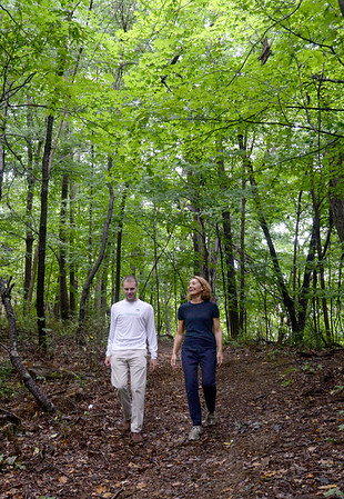 BRYAN EATON/Staff photo. Andrew Mahoney of MassLift Americorp and Mary Williamson, director of development and community engagement for Essex County Greenbelt walk down the trail on the southern end of Whittier Hill just above Whitcher Court across from Amesbury Town Park.