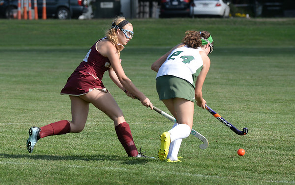 BRYAN EATON/Staff photo. Newburyport's Lindsey Hurst moves in on Pentucket's Ashlyn Newell.