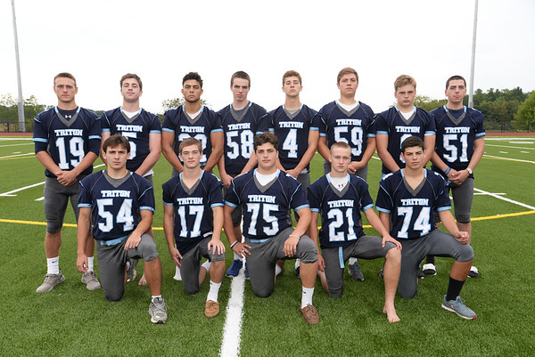 BRYAN EATON/Staff photo. Seniors on the Triton High football team, front, from left, Louis Takesian, Ricky Calvani, John Falasca, Bryan Hughes and Matthew Pike. Back, from left, Lewi L'Heureux, Liam Spillane, Nicolas Vines, Jack McCarthy, Chris Trotta, Kenny Shute, Bryan Wideberg and Sean Driscoll.