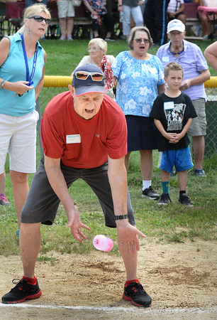 BRYAN EATON/Staff Photo. Robert Morris of Salisbury misses the water balloon in the sixth round of the Water Balloon Toss, it breaking on the ground. He was at the Salisbury Council on Aging's Senior Field Day at Lion's Park.