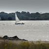 BRYAN EATON/Staff photo. A sailboat catches a west wind as they sail down the Merrimack River on the last day of summer in a view from Salisbury Beach State Reservation.