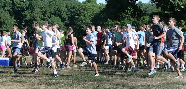 BRYAN EATON/Staff photo. The Newburyport High boys cross country team  warm up at Maudslay State Park.