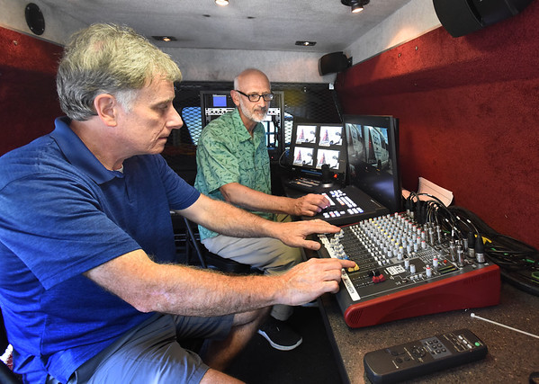 BRYAN EATON/Staff photo. Chris Donnellan, operations manage, left, and Lance Wisniewski, executive director can control on site broadcasting from SCTV's new van.