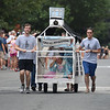 JIM VAIKNORAS/Staff photo THe bed from the Old South Church race in the Lions Club Bed Race on Federal Street in Newburyport Thursday night.