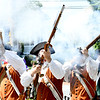 JIM VAIKNORAS/Staff photo The Acton Company fire their muskets on High Street in the Yankee Homecoming Parade Sunday.