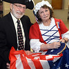 CARL RUSSO/staff photo. Frank Picariello and his wife Patty Barton as Betsy Ross. Her family are original settlers of Seabrook. As part of  Seabrook's 250th anniversary, a grand ball banquet was held Friday night at the Raymond E. Walton American Legion, Post 70 hall. Over 50 People attended with some dressed in colonial attire. The dinner of prime rib and chicken was catered by Three Sisters Catering of Seabrook. Bill Manzi, Seabrook's Town Manager opened the event by recognizing Oliver Carter Jr. , Chairman of the 250th. Anniversary Committee and introducing Bruce Brown, owner of the famous Brown's Lobster Pound.  Brown spoke briefly and reminisce about attending  Seabrook's 200th. anniversary celebration. Several people at the banquet also attended the 200th. anniversary.   8/17/2018