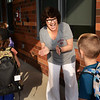 BRYAN EATON/Staff photo. Bresnahan School principal Kristina Davis greets students as Newburyport Schools started the school season on Tuesday.