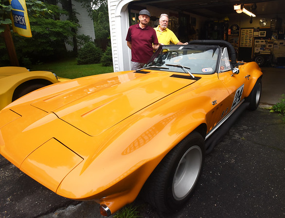 BRYAN EATON/Staff photo. Wes Pettengill, left, with Jerry Lischke of Newburyport,  built this corvette out of various cars and will be in Thursday's car show.