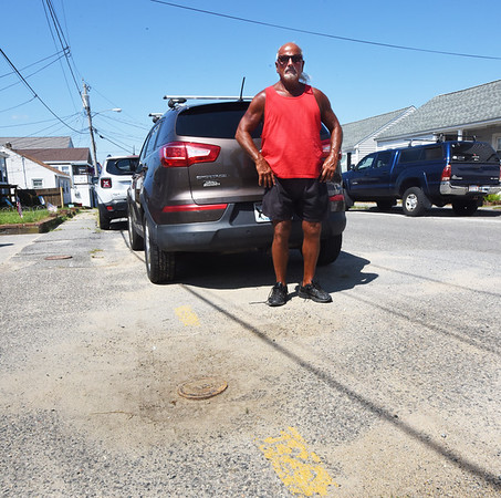 BRYAN EATON/Staff photo. Lou Papandrea and his wife, Cheryl, had their car towed on Vermont Street at Salisbury Beach. They claim there's no signage that said they couldn't park there and have notice other vehicles in the same spot had not been towed.