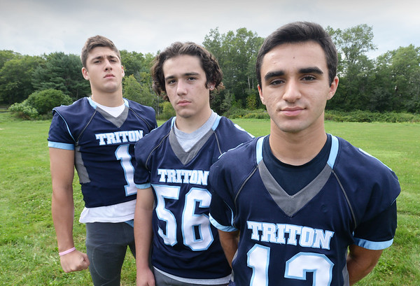 BRYAN EATON/Staff photo. Triton High School football captains, from left, Dylan Shute, Jon Rolfe and Jack Tummino.