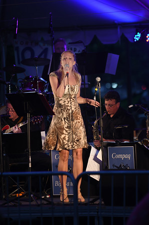JIM VAIKNORAS/Staff photo Marina Evans fronts the Compaq Jazz Band Saturday night in Market Landing Park.