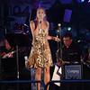 JIM VAIKNORAS/Staff photo Marina Evans fronts the Compaq Jazz Band Saturday night in Market Landing Park.