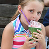 JIM VAIKNORAS/Staff photo McKenna Coleman, 6, of Peabody enjoys a frozen treat in Market Square during Yankee Homecoming Tuesday.