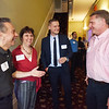 BRYAN EATON/Staff photo. Wil Carpenter, left, vice president of the Merrimack Valley Chamber of Commerce meets with Essex Inn owners Lori Guertin, and John Guertin, right, and general manager Alexander Thompson, center, at a recent chamber mixer.