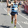 JIM VAIKNORAS/Staff photo Julian Oakley edges out Daniel Winn to win the High Street Mile Sunday morning in Newburyport.