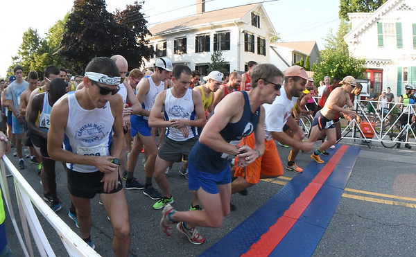 JIM VAIKNORAS/Staff photo  Runners check their watches at the start of the 10 mile in the Newburyport Lions Club Yankee Homecoming Road Race.