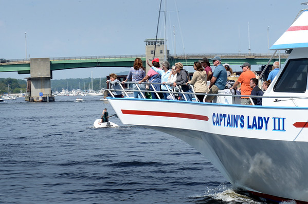 BRYAN EATON/Staff photo. The Captain's Lady III heads back to dock at the Newburyport waterfront after a whale watching excursion to Jeffreys Ledge. One enthusiastic man disembarking with his children said they saw several whales on the Saturday morning trip.