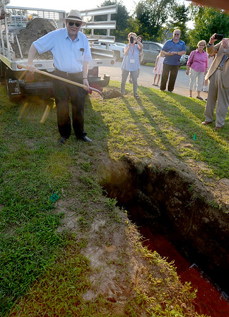 JIM VAIKNORAS/Staff photo Seabrook resident Bruce Brown, 81, throws a shovel full of dirt over a time capsule being bury at the American Legion in Seabrook as part of the town's 250th anniversary celebration. The capsule included police and fire dept hats, a hard drive from the library, coins, messages and much more. It will be opened in 50 years in 2068.