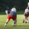 BRYAN EATON/Staff photo. Amesbury High football players go through drills on their third day of practice.