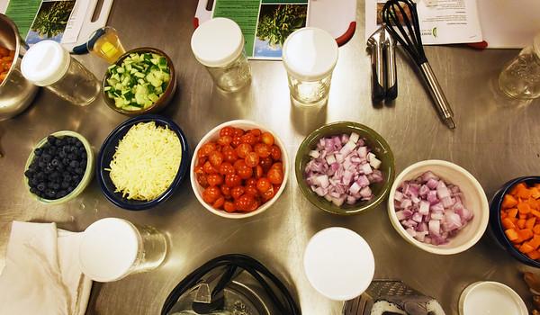 BRYAN EATON/Staff photo. Veggies prepped and Mason jars ready for Southwestern corn Mason jar salads.