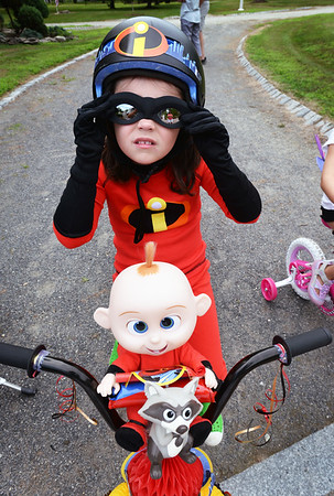 BRYAN EATON/Staff photo. Jennifer Collins, 6, of Byfield dresses as a character in Incredibles 2 in the Kids Day in the Park Carriage and Bicycle Parade.