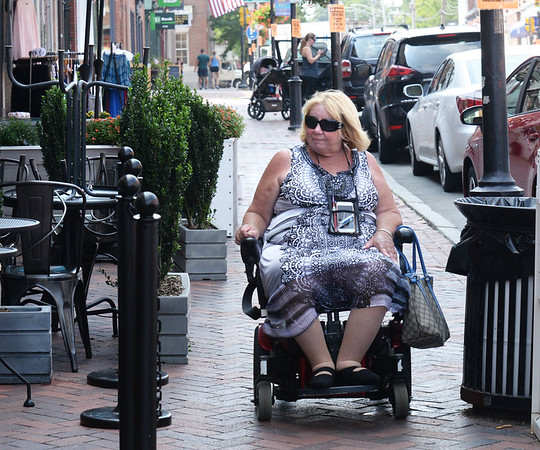 BRYAN EATON/Staff photo. Lisa Rowan who is on Newburyport's Commission for Disabilities recently gave the Daily News a tour of the downtown.